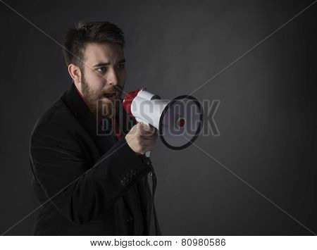 Talking Young Man Using Megaphone