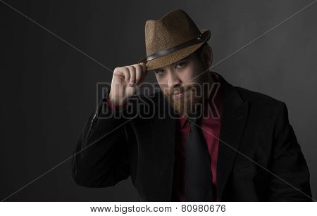 Gorgeous Man in Formal Wear Holding his Brown Hat