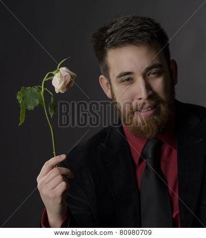 Smiling Handsome Goatee Man Holding Withered Rose