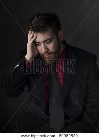 Young Man in Formal Attire Suffering Headache