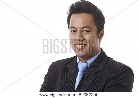Closeup portrait of happy Asian businessman looking at camera, smiling.