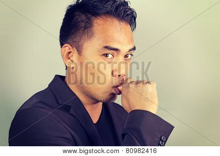 sad Asian businessman