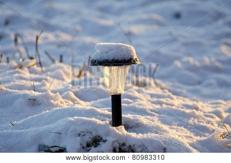 Snowy Solar Garden Lamp In Winter