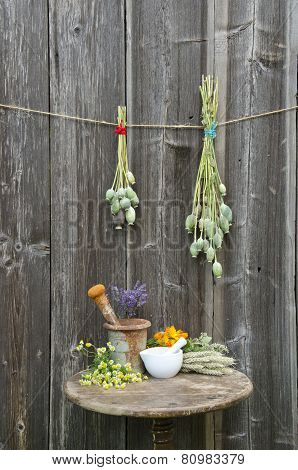 Mortars On Old Table And Various Herbal Medicine Summer Flowers