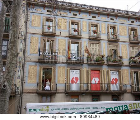 Barcelona, Spain - Feb 9, 2014: Young Woman At Balcony Invites People From Rambla Street To Visit Er