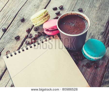 Macaroons Cookies, Espresso Coffee Cup And Sketch Book On Wooden Rustic Table, Vintage Stylized Phot