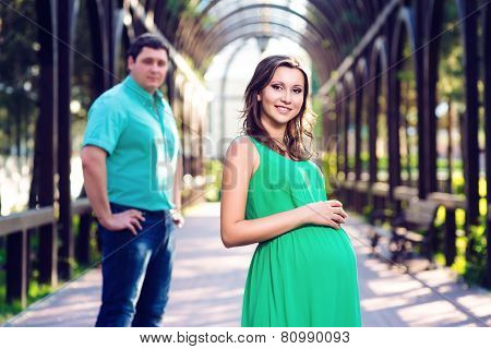 Toned photo of beautiful loving couple awaiting baby. Husband and wife maternity expecting a child o