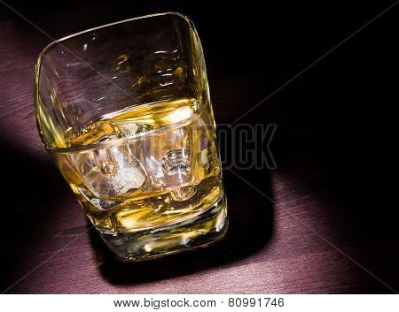 Drink Series, One Glass Of Whiskey With Ice On Old Wood Table And Hard Light