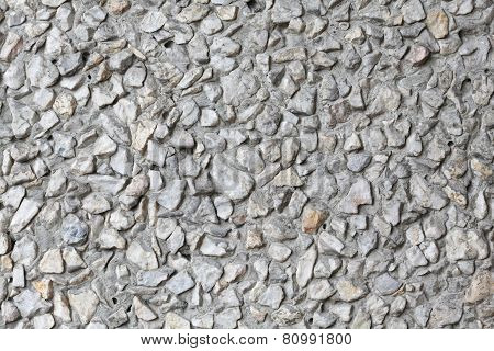 Old wall of small pebbles
