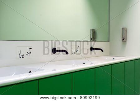 Mirror And Faucet In Public Bathroom.