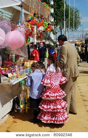 Spanish family at a snack stall, Seville.