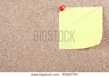 Blank Yellow Note Pinned To Corkboard
