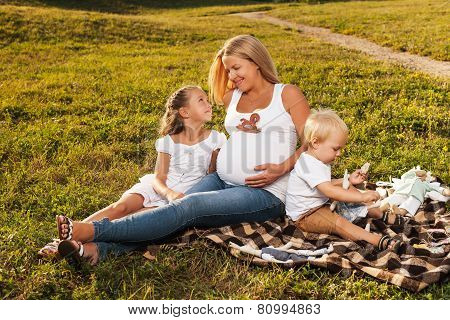 Pregnant Woman With Her Kids