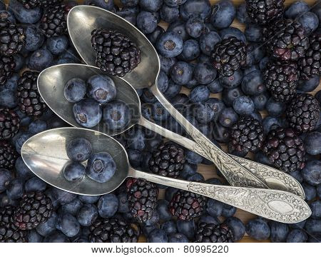 Fruit In Rustic Table Setting With Vintage Spoons