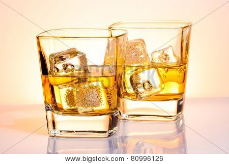 A Pair Of Glasses Of Whiskey With Ice