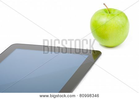 Detail Of Digital Tablet Pc Near Green Apple On White Background