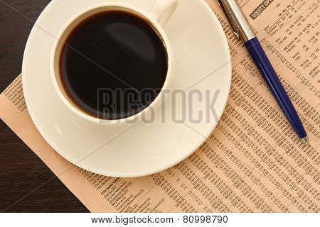 A white cup of coffee on paper table numbers
