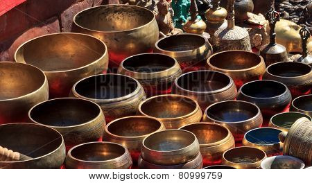 Several Singing Bowls At A Bazaar