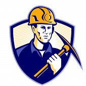 foto of ax  - Illustration of a coal miner holding a pick ax facing front set inside shield done in retro style - JPG