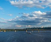 stock photo of barge  - The barge floating in the blue Dnieper waters against the summer Kyiv landscape - JPG