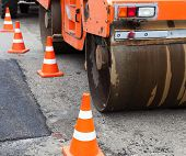 pic of paved road  - Tandem road roller and traffic cones on the road construction - JPG