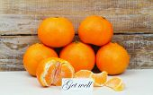 stock photo of wishing-well  - Get well card with mandarines with rustic wood background - JPG