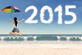 pic of leaping  - Rear view of woman holding umbrella and leaping frog style on beach celebrate new year - JPG