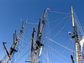 picture of yardarm  - Three masts rising into the air on old tallship - JPG