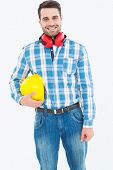 stock photo of muffs  - Portrait of confident manual worker with hardhat and ear muffs on white background - JPG