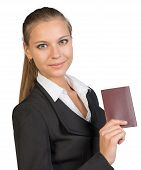 image of passport cover  - Businesswoman showing passport with blank cover - JPG