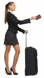 picture of passport cover  - Businesswoman standing with wheeled travel bag - JPG