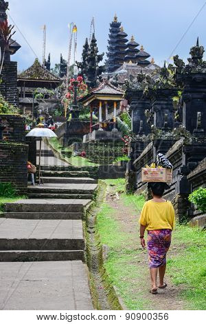 Balinese People Walk In Traditional Dress In Pura Besakih