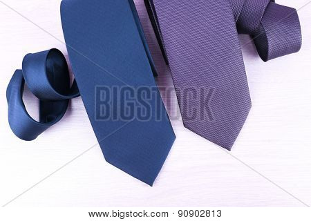 Elegance ties on wooden table background