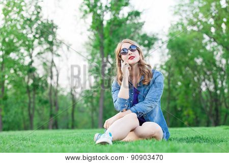 Girl With Mobile Phone On Grass