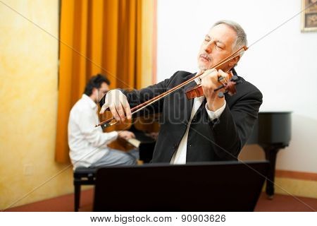 Violinist and pianist playing together