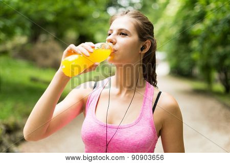Young woman drinking after sport