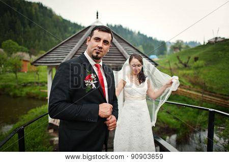 Wedding Couple At The Small Bridge