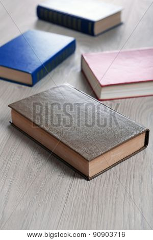 Heap of books on wooden background