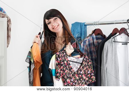 Beautiful Young Woman Holding Dresses