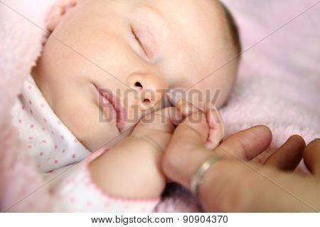 Sleeping Baby Girl Holding Mother's Hand