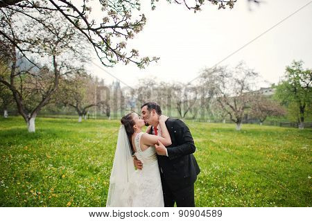 Wedding Couple Dancing Under The Rain