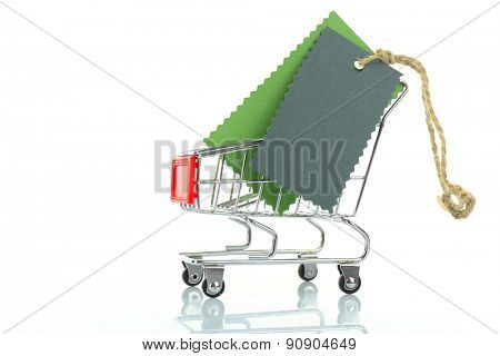 Blank tags in metal cart isolated on white
