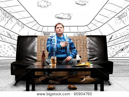 happy soccer or football fan with hand on heart on sofa at sketch stadium