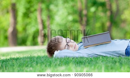 Young Boy With A Book Slipping