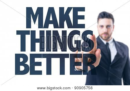 Business man pointing the text: Make Things Better