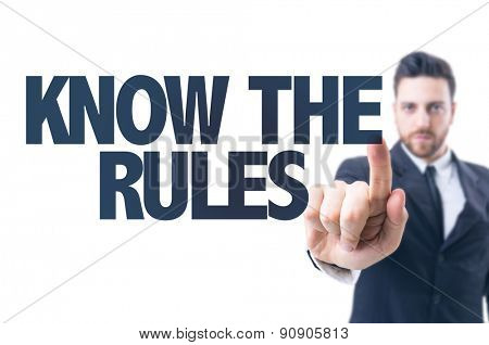 Business man pointing the text: Know the Rules