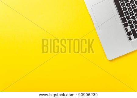Laptop Computer On Yellow Background,