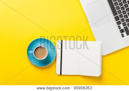 Cup And Notebook Near Laptop Comuter