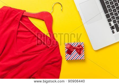 Gift Box And Dress With Laptop Computer