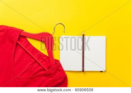 Dress With Hanger And Notebook